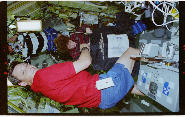 STS078-307-002 - STS-078 - BDPU, Helms changes out film magazine during LMS-1 Spacelab mission