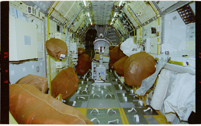 STS078-332-006 - STS-078 - Interior of Spacelab module filled with brown stowage bags