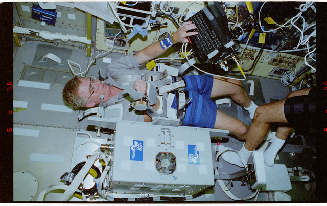 STS078-346-020 - STS-078 - TVD, Brady collects data during LMS-1 Spacelab mission
