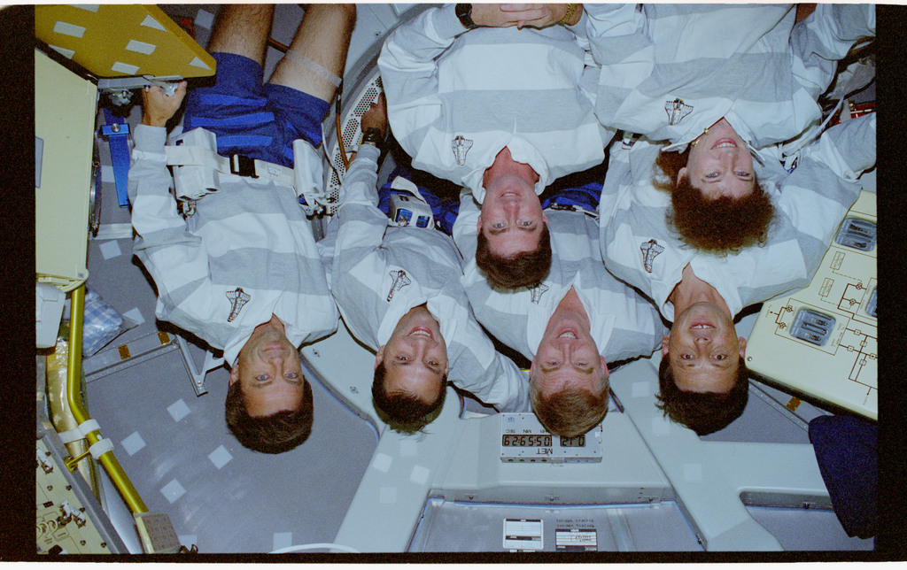 STS078-354-004 - STS-078 - STS-78 crew attempts a crew portrait in the Spacelab tunnel adapter hatch