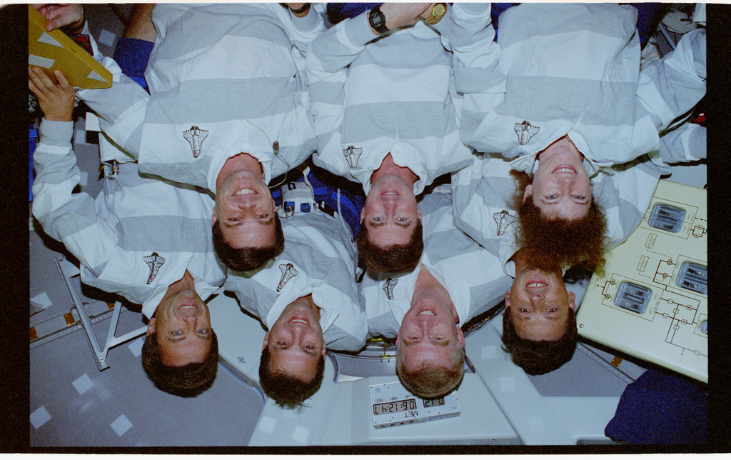 STS078-354-025 - STS-078 - STS-78 crew portrait in the Spacelab tunnel hatch