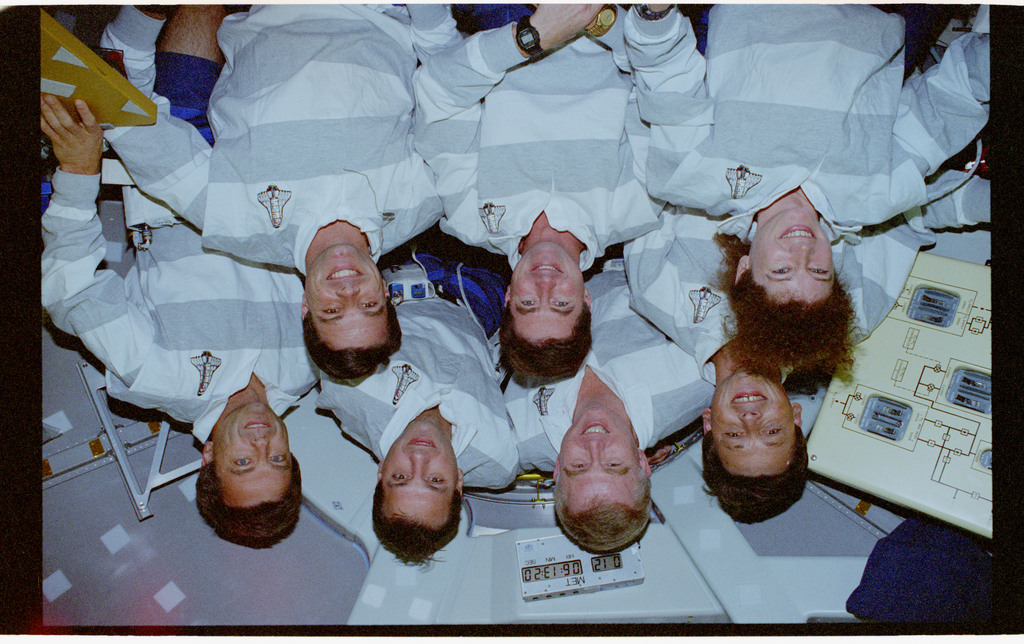 STS078-354-028 - STS-078 - STS-78 crew portrait in the Spacelab tunnel hatch