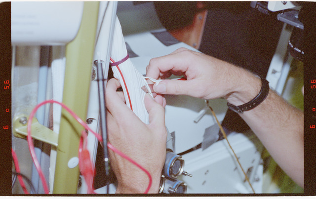 STS078-400-023 - STS-078 - Inflight Maintenance (IFM) on BDPU wiring