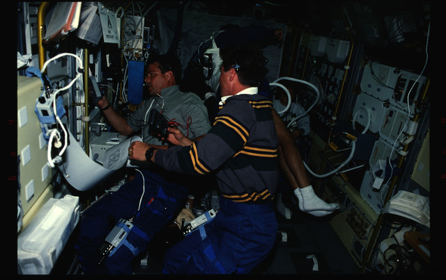 STS078-419-021 - STS-078 - Kregel and Henricks perform IFM on BDPU LMS-1 experiment