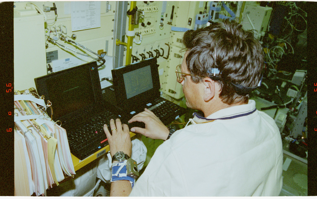 STS078-429-001 - STS-078 - SACS, Favier completes mood survey on PGSC in Spacelab during LMS-1 mission