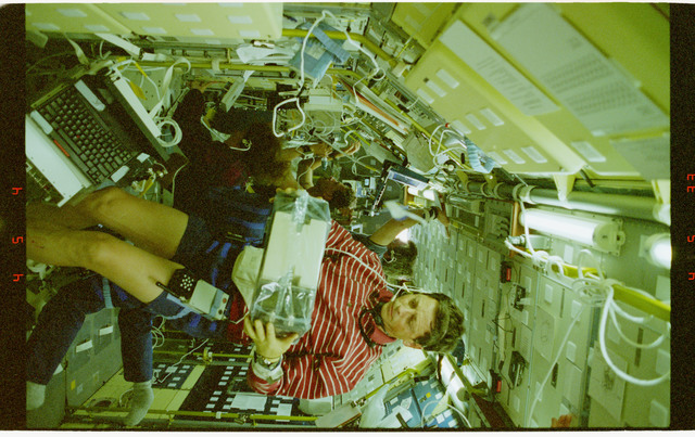 STS078-431-033 - STS-078 - BDPU, Favier holds test chamber in LMS-1 Spacelab