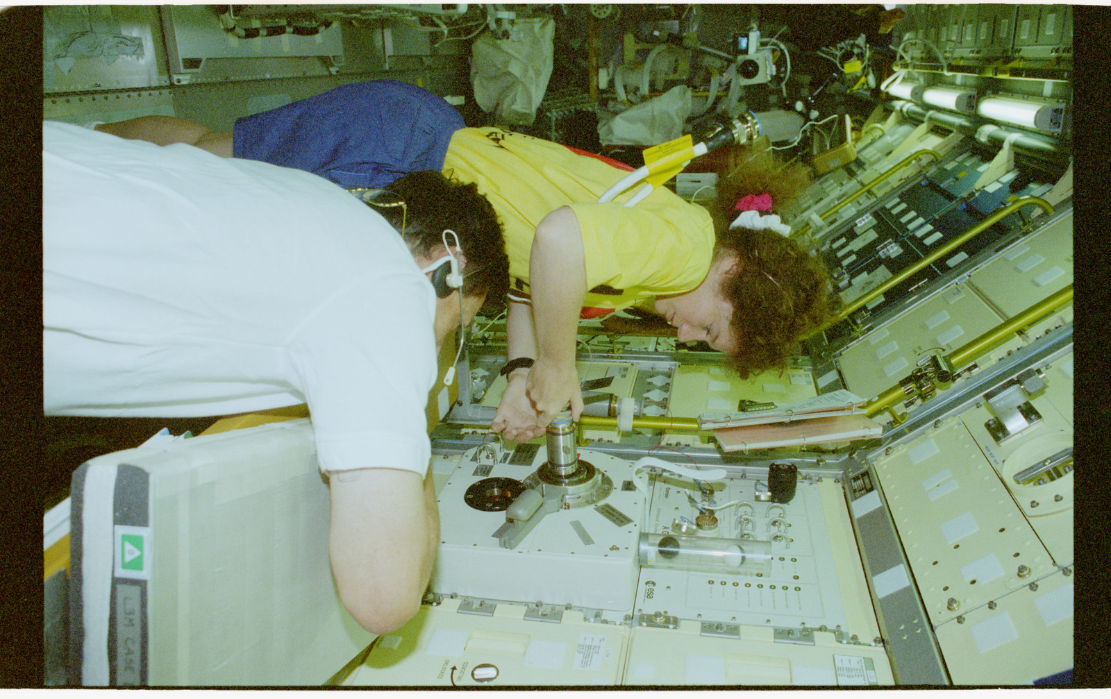 STS078-440-033 - STS-078 - AGHF, Helms inserts a sample into the LMS-1 Spacelab core facility module