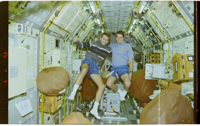 STS078-445-037 - STS-078 - Crewmember activity in Spacelab and middeck during cleanup
