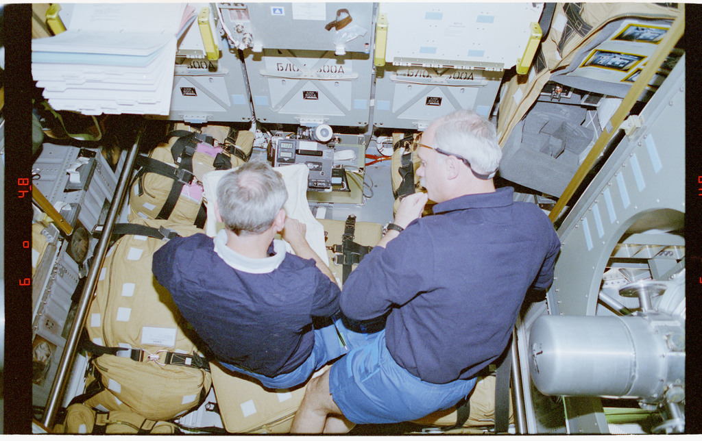 STS079-301-030 - STS-079 - Akers and Readdy review stowage items in Spacehab module
