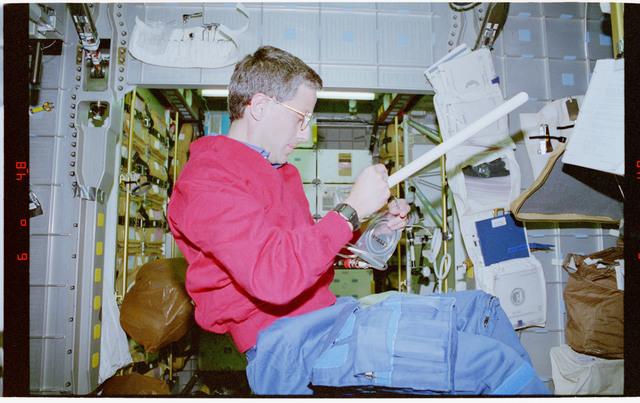 STS079-302-017 - STS-079 - ETTF - Astronaut Apt prepares to insert sample into ETTF