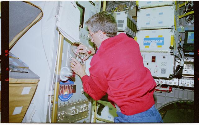 STS079-302-018 - STS-079 - ETTF - Astronaut Apt prepares to insert sample into ETTF