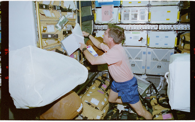 STS079-302-019 - STS-079 - Astronaut Blaha checks stowage items in the Spacehab module