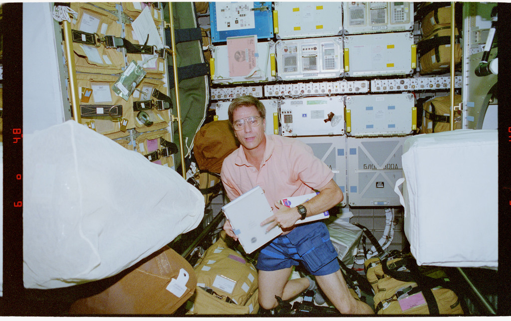 STS079-302-020 - STS-079 - Astronaut Blaha checks stowage items in the Spacehab module