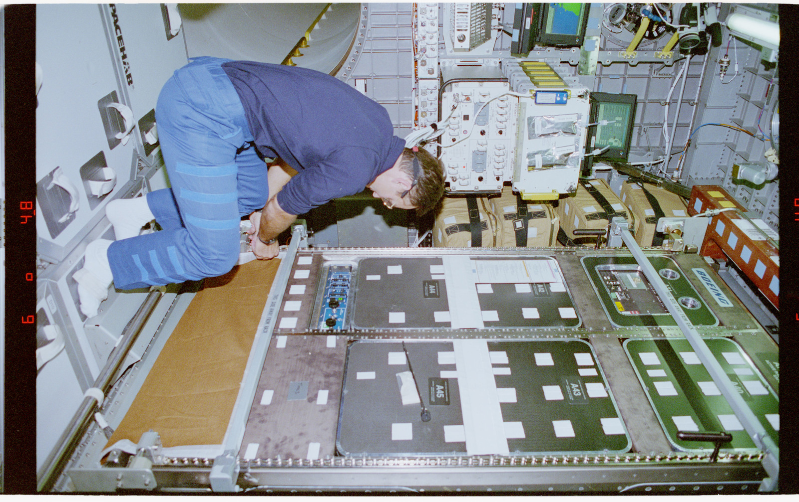 STS079-302-023 - STS-079 - RME 1313 - Active Rack Isolation System being locked down