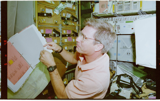 STS079-302-026 - STS-079 - Astronaut Blaha checks stowage items in the Spacehab module