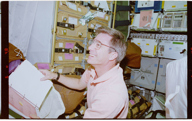 STS079-302-028 - STS-079 - Astronaut Blaha checks stowage items in the Spacehab module