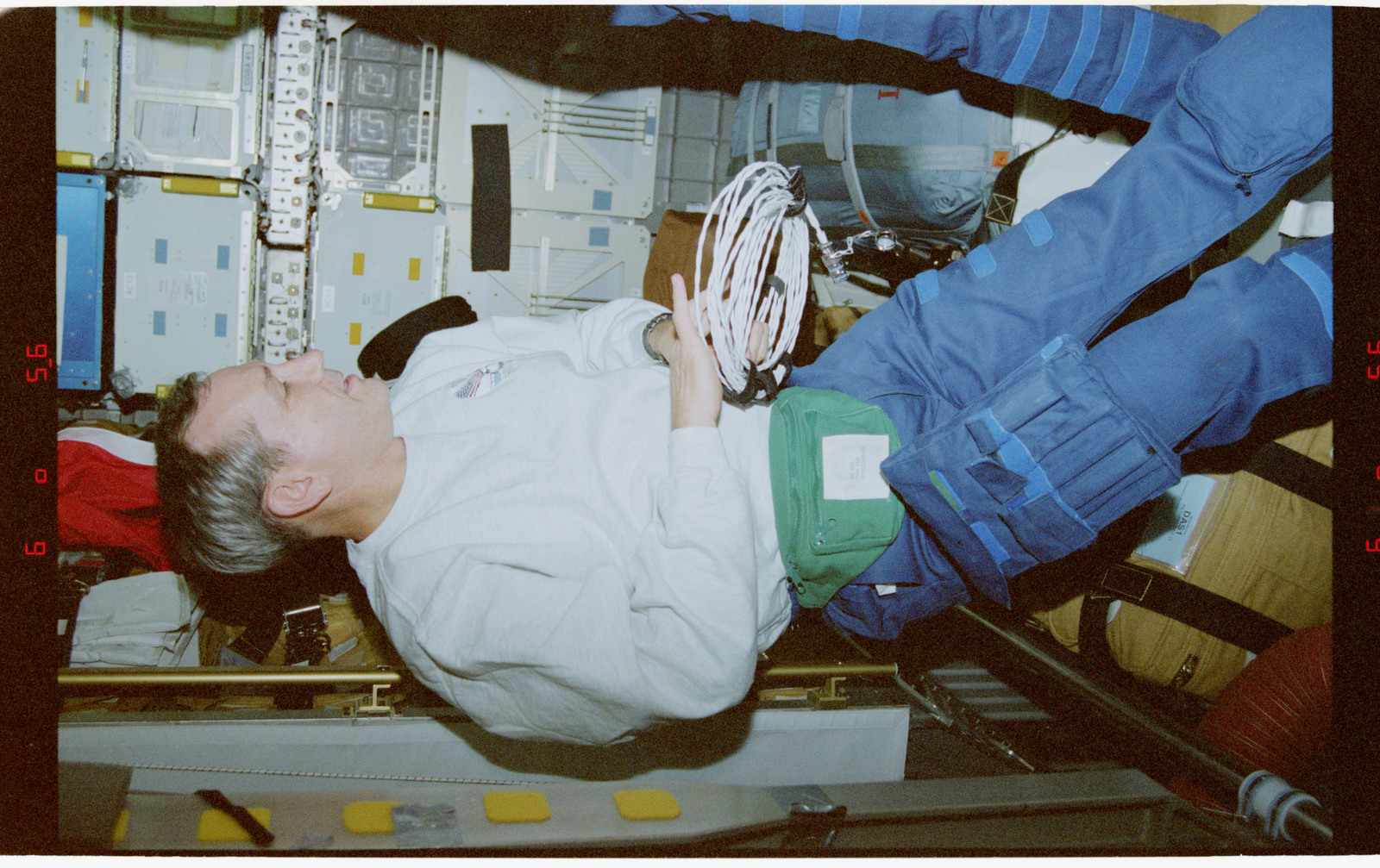 STS079-342-017 - STS-079 - STS-79 crew activities in the Spacehab module and the transfer tunnel
