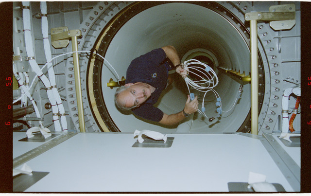 STS079-342-020 - STS-079 - STS-79 crew activities in the Spacehab module and the transfer tunnel