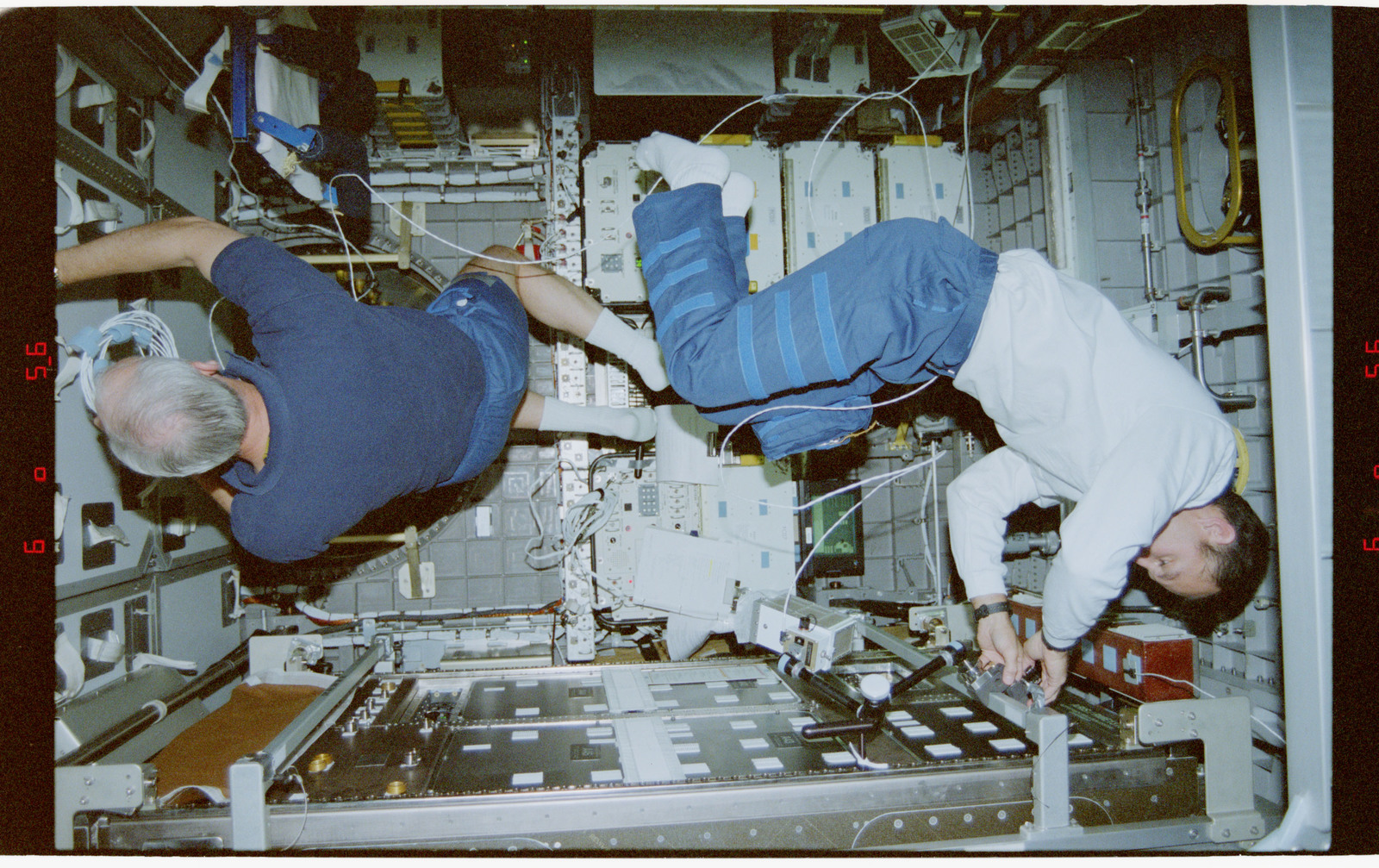 STS079-342-021 - STS-079 - STS-79 crew activities in the Spacehab module and the transfer tunnel