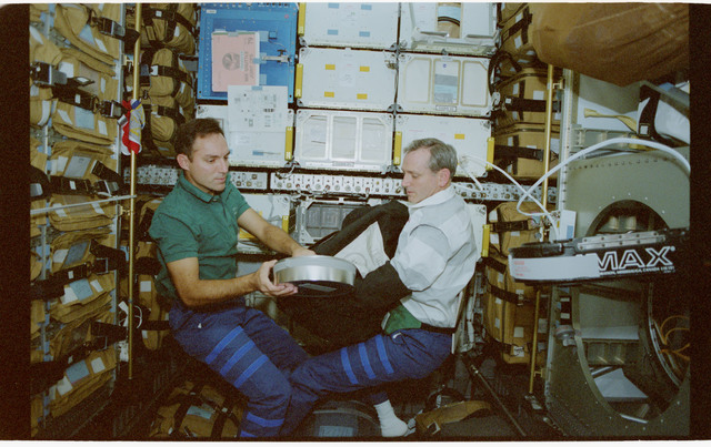 STS079-347-015 - STS-079 - Astronauts Walz and Akers change out IMAX film canister