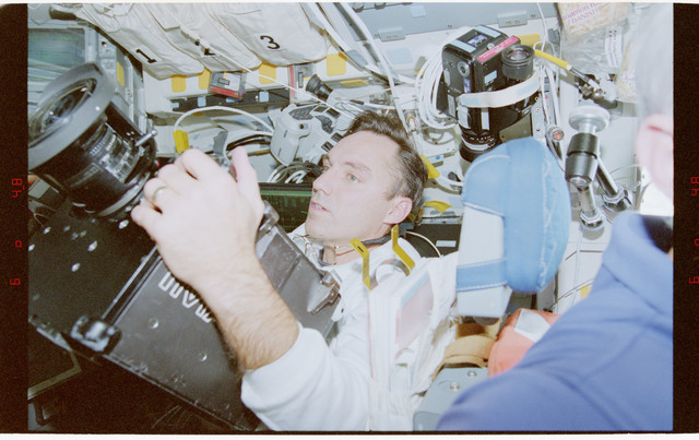 STS079-362-022 - STS-079 - Astronaut Walz on flight deck with IMAX camera