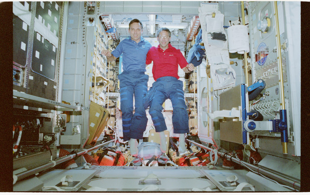 STS079-364-035 - STS-079 - Astronauts Walz and Apt in Spacehab with the ARIS module