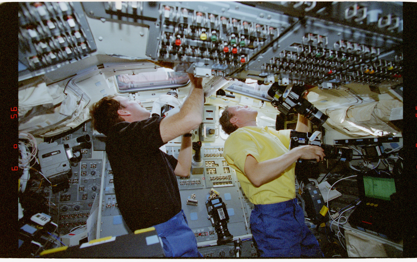 STS080-310-012 - STS-080 - Crewmembers photograph the Earth from the shuttle flight deck