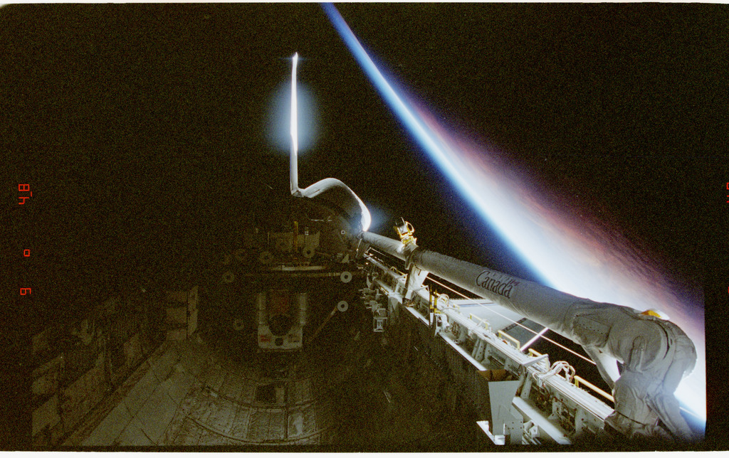 STS080-317-001 - STS-080 - Views of the payload bay against backdrop of Earth terminator