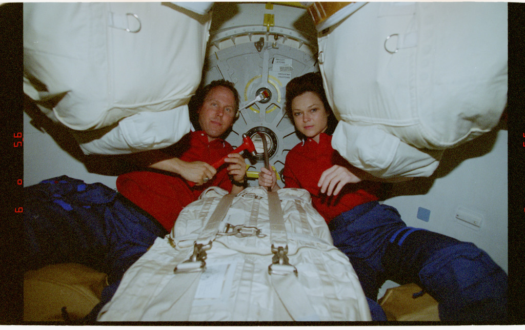 STS080-317-015 - STS-080 - Mission Specialists Jones and Jernigan pose for photos in airlock