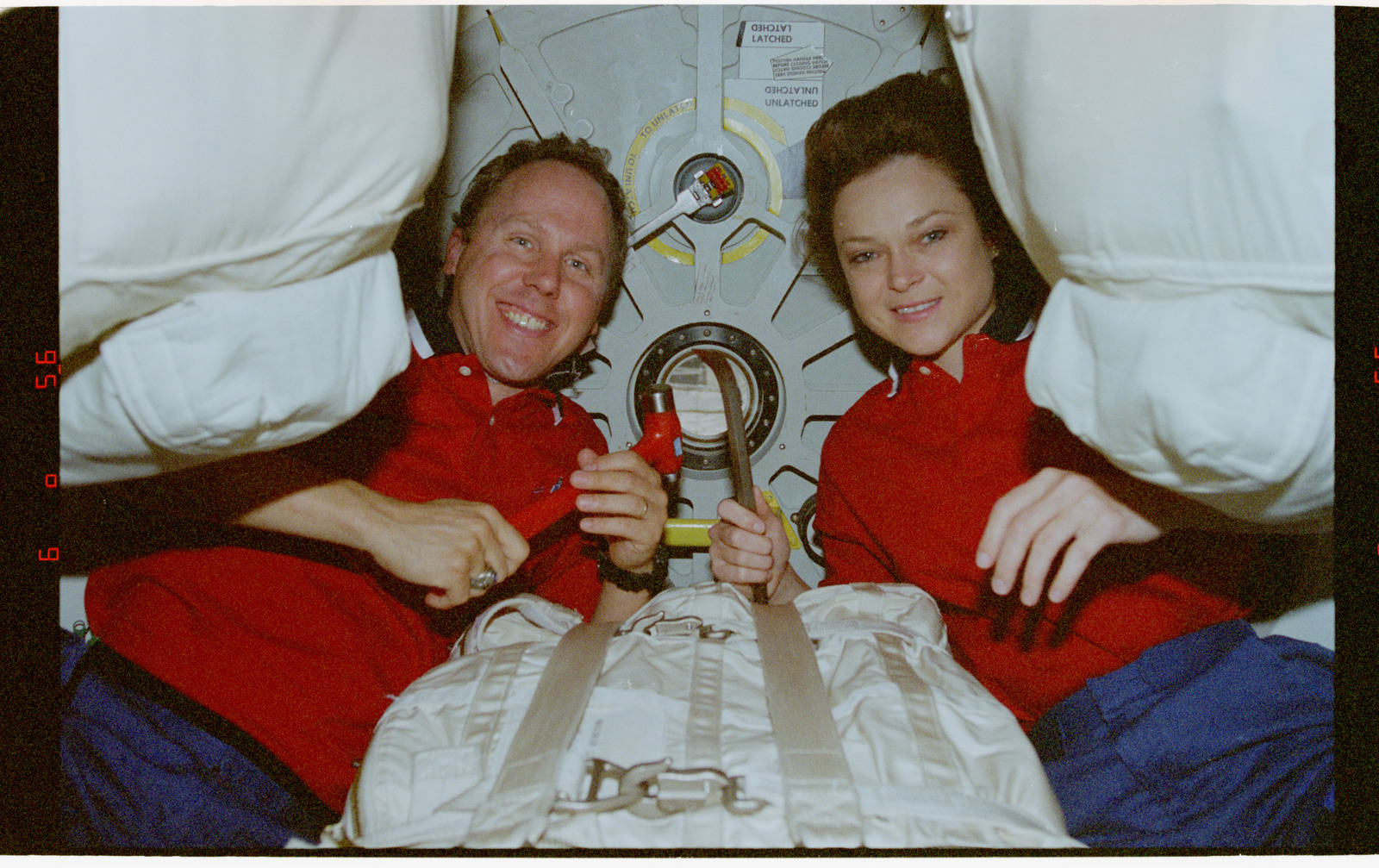 STS080-317-016 - STS-080 - Mission Specialists Jones and Jernigan pose for photos in airlock