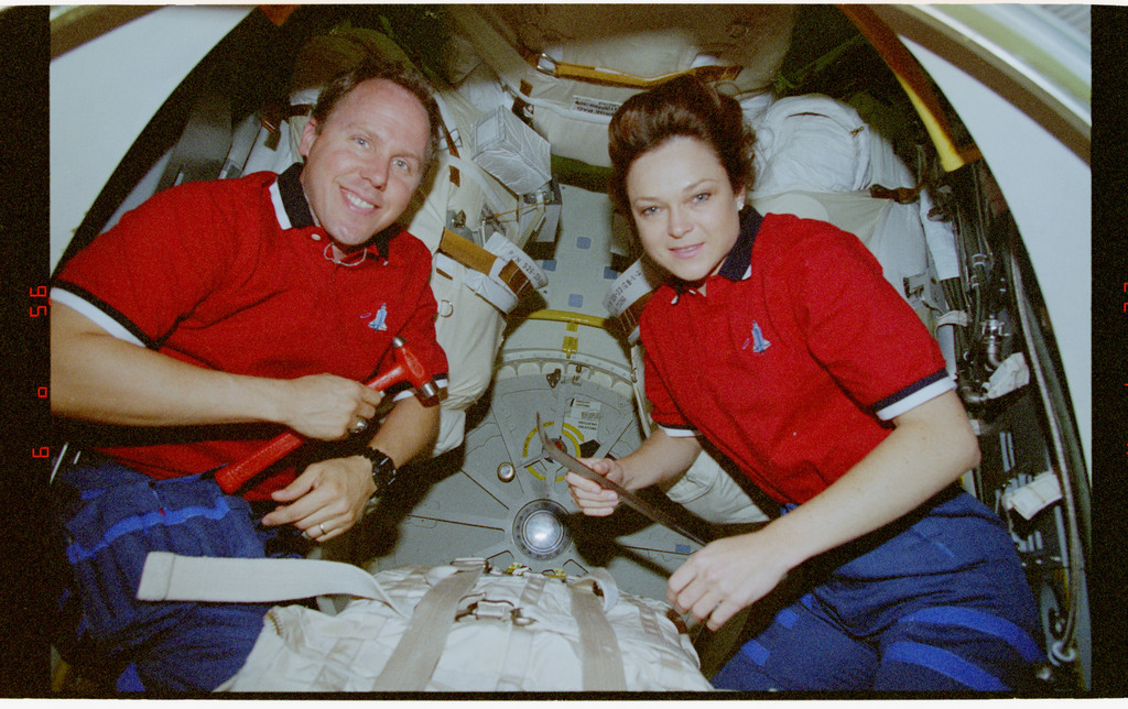 STS080-317-018 - STS-080 - Mission Specialists Jones and Jernigan pose for photos in airlock