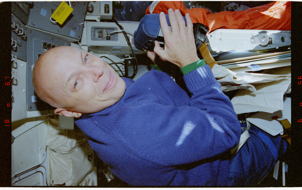 STS080-318-020 - STS-080 - Crewmember activity in the flight deck and middeck