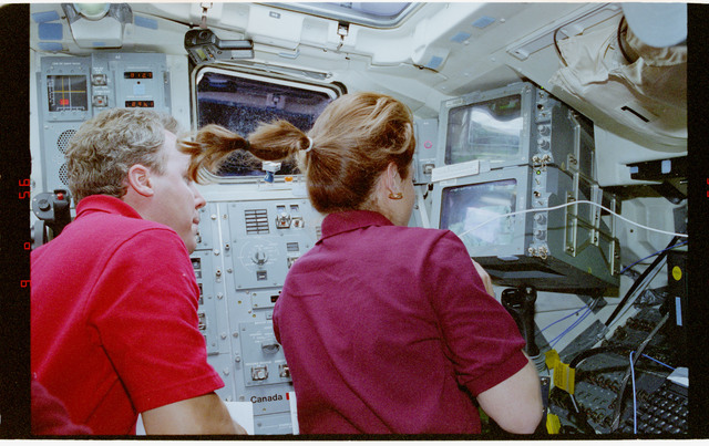 STS080-325-011 - STS-080 - Crewmember activities in flight deck