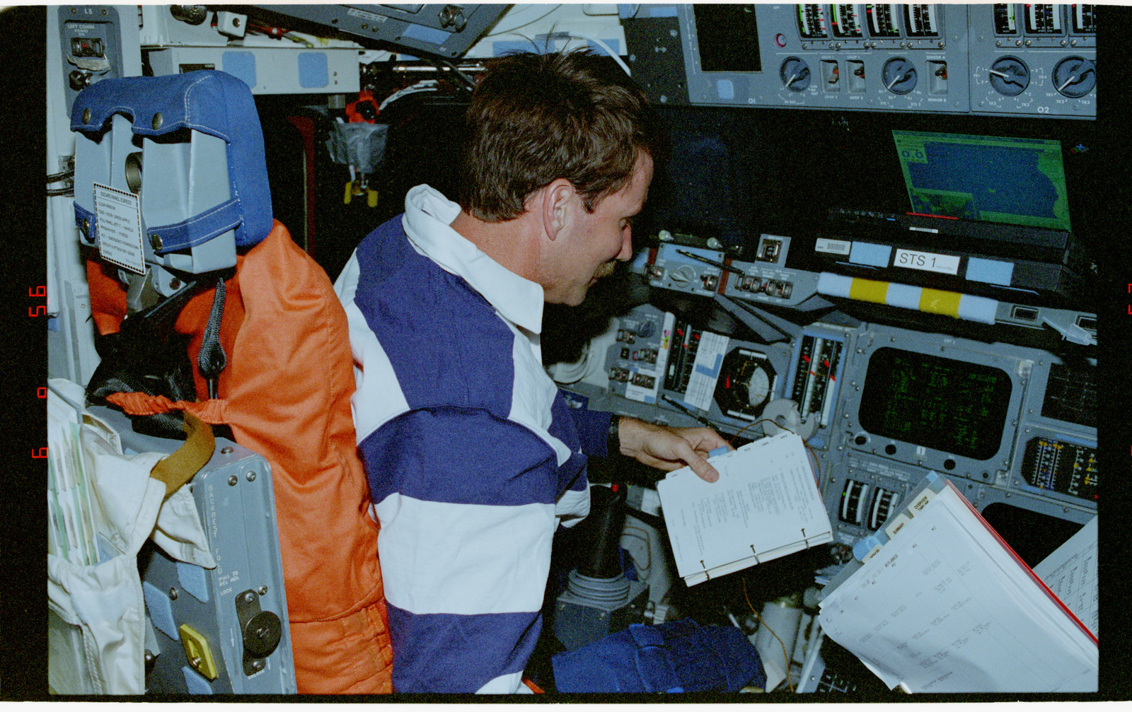 STS080-325-023 - STS-080 - Rominger conducts stationkeeping activities from the commander's station