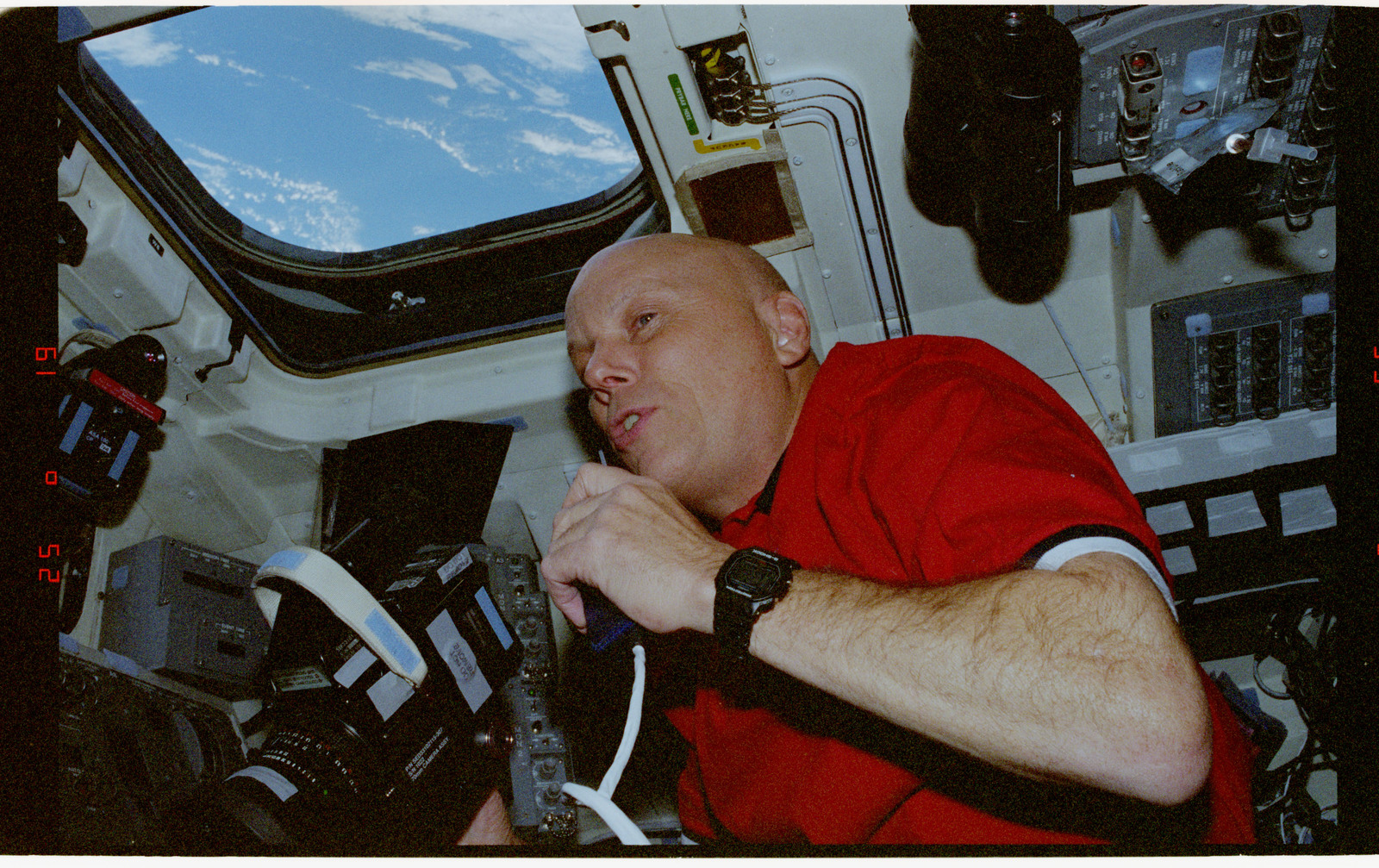 STS080-325-027 - STS-080 - Crewmember activities in the shuttle flight deck