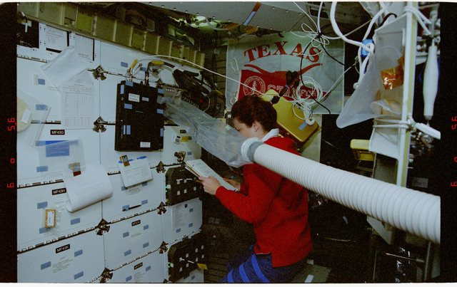 STS080-345-014 - STS-080 - CMIX-05, plastic bag on air ventilation duct blows air onto middeck locker
