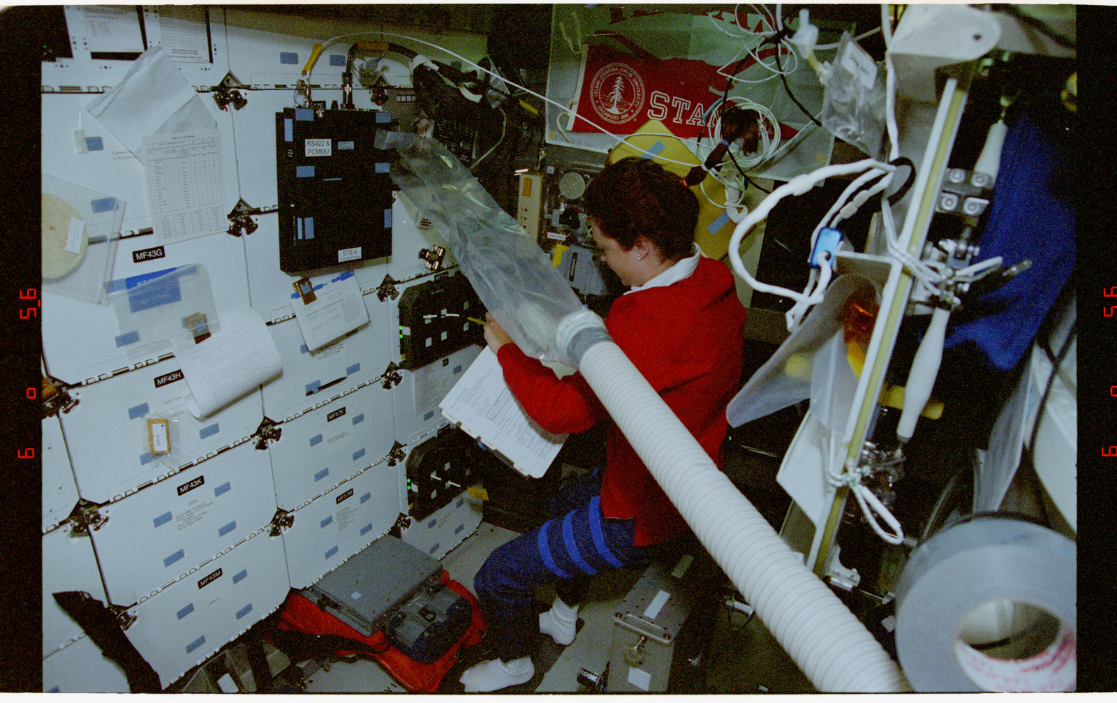 STS080-345-015 - STS-080 - CMIX-05, plastic bag on air ventilation duct blows air onto middeck locker