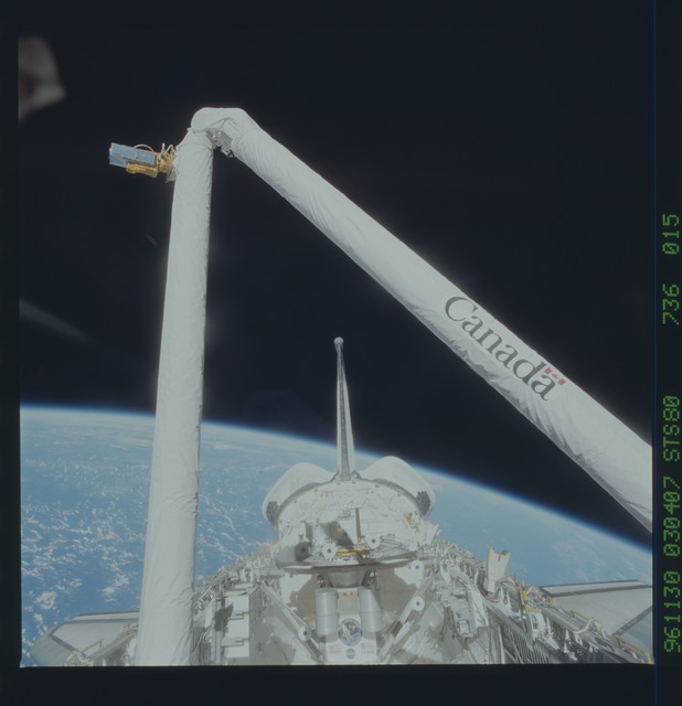 STS080-736-015 - STS-080 - View of the RMS arm bent over the payload bay