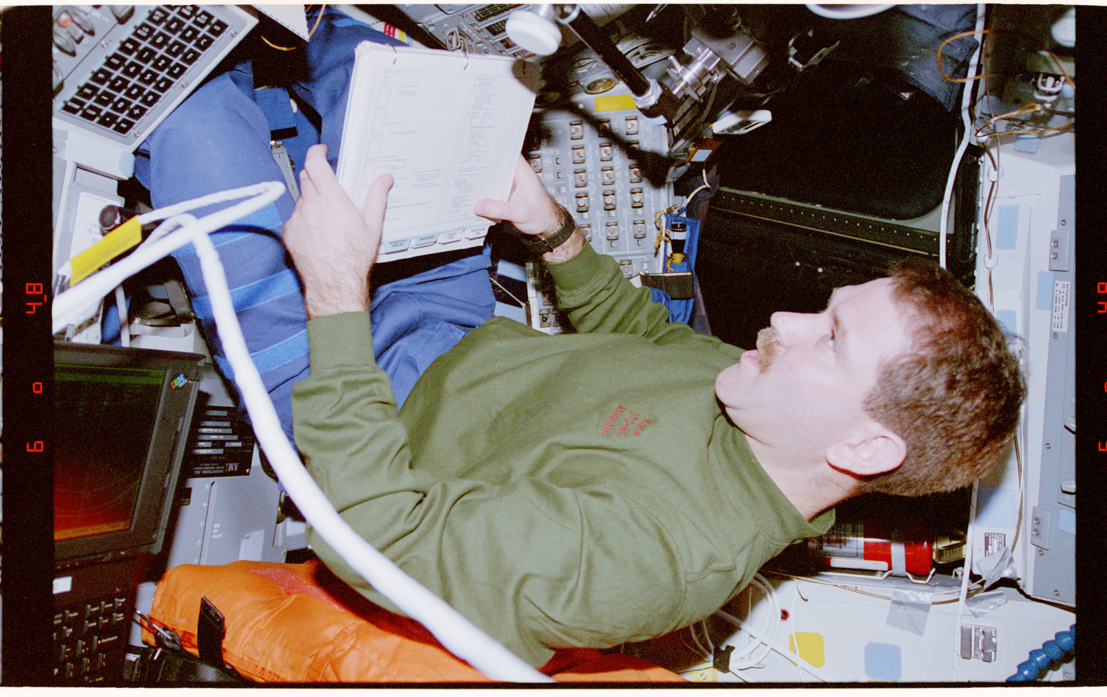 STS081-311-027 - STS-081 - STS-81 crew activities during undocking with Mir space station