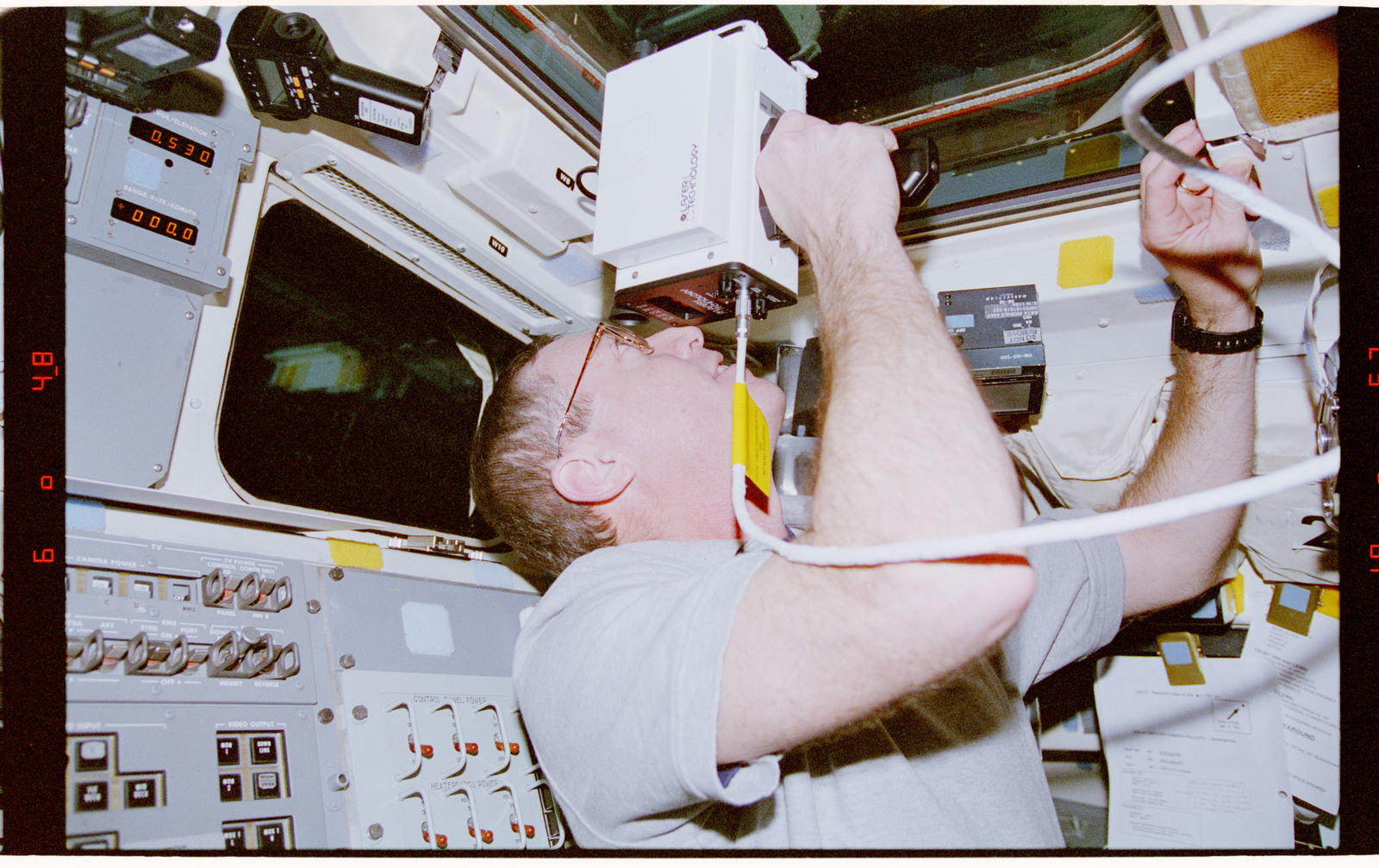 STS081-311-031 - STS-081 - STS-81 crew activities during undocking with Mir space station