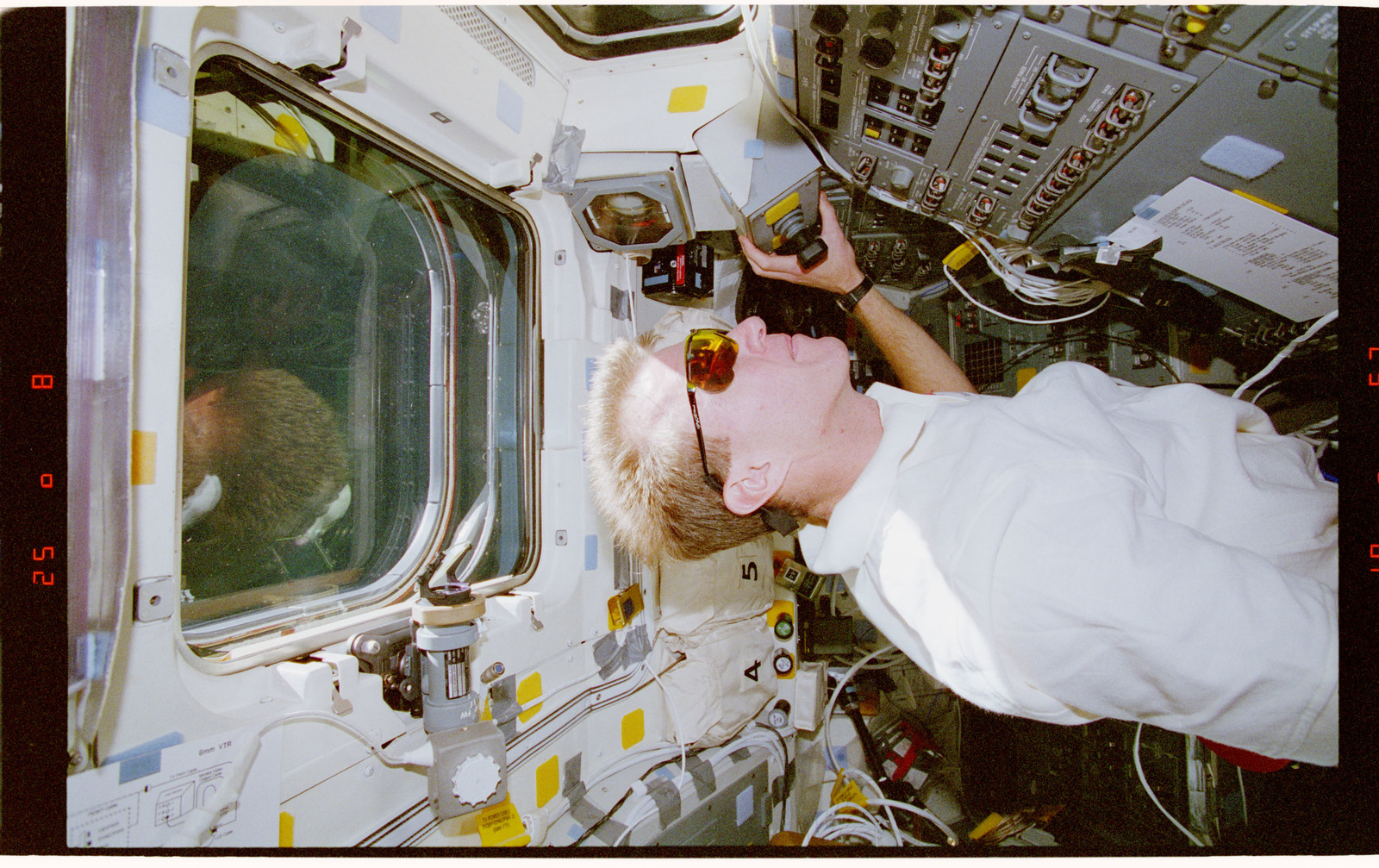 STS081-311-033 - STS-081 - STS-81 crew activities during undocking with Mir space station