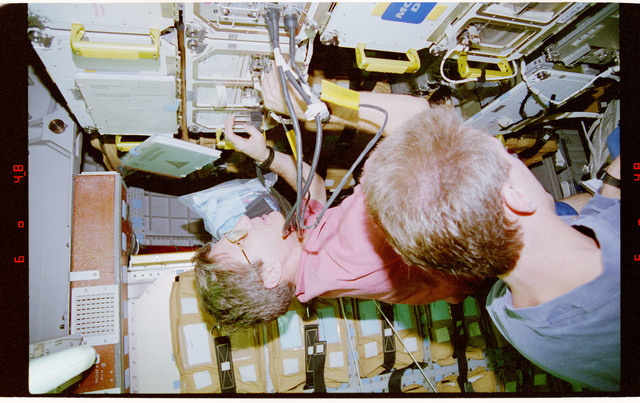 STS081-312-021 - STS-081 - BTS - Blaha and Jett transfer hardware to Spacehab