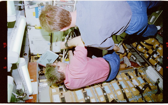 STS081-312-023 - STS-081 - BTS - Blaha and Jett transfer hardware to Spacehab