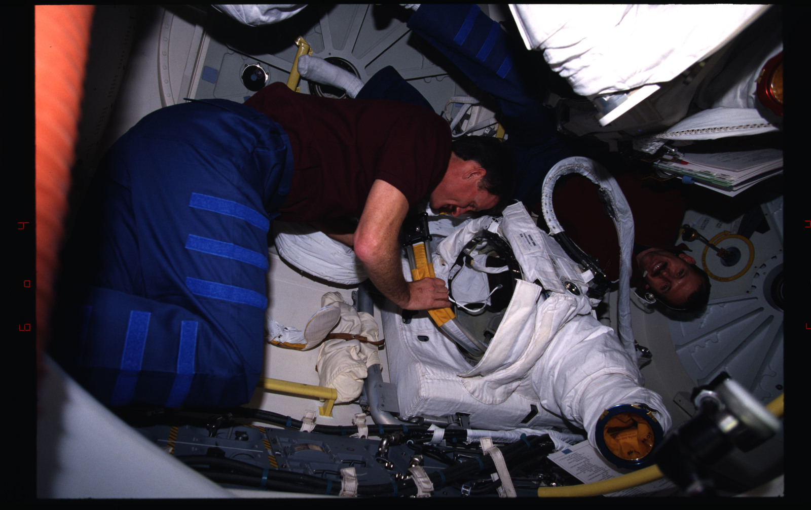 STS082-333-016 - STS-082 - Crewmember activities in the shuttle middeck and flight deck