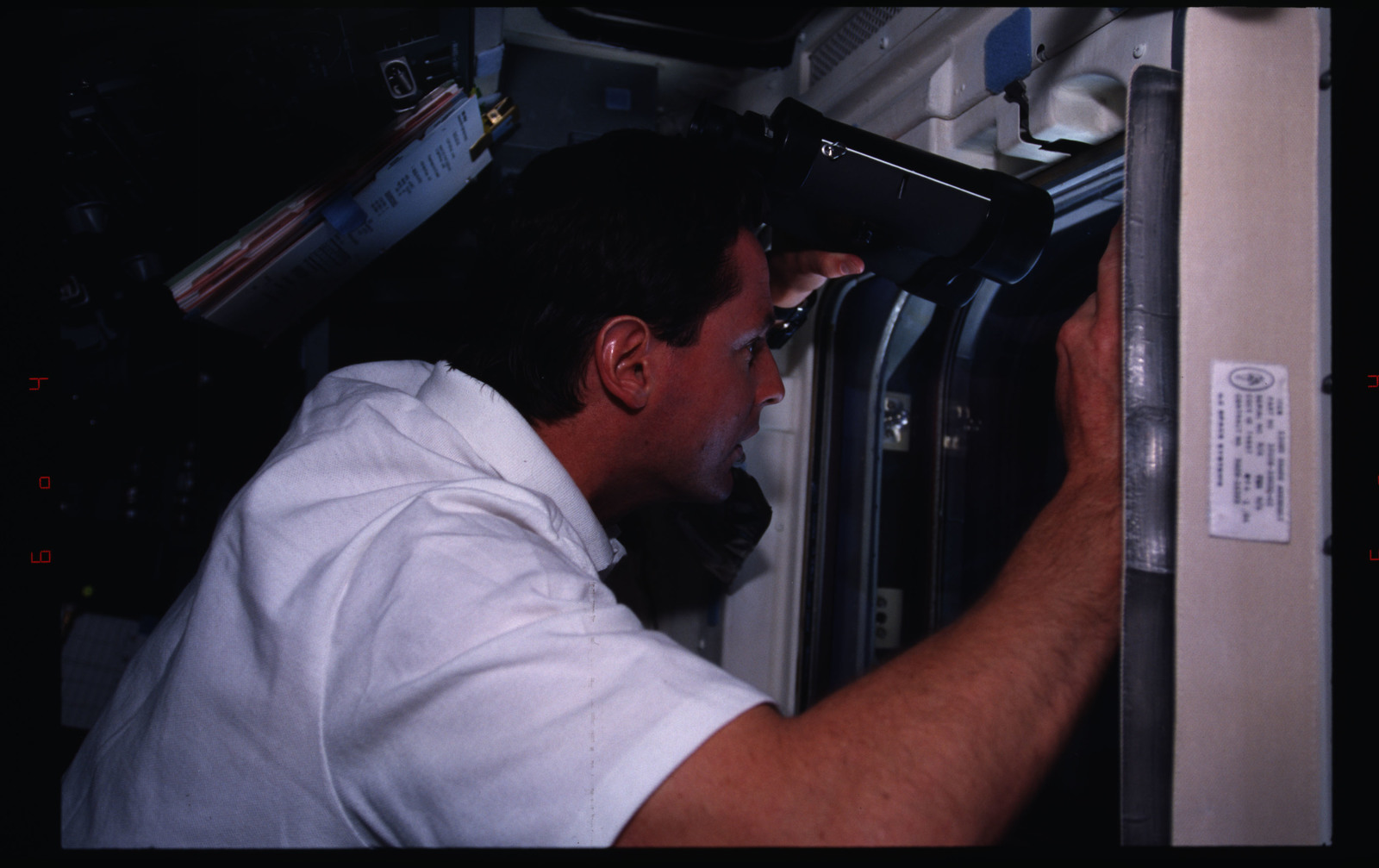 STS082-333-028 - STS-082 - Crewmember activities in the shuttle middeck and flight deck