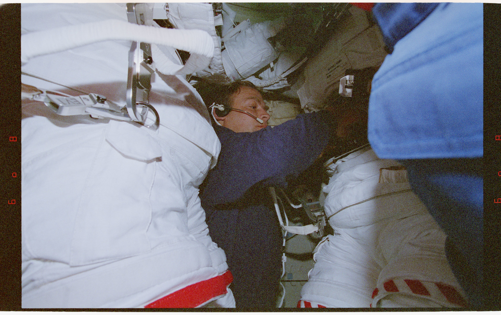 STS082-356-034 - STS-082 - Suiting up activities in the external airlock