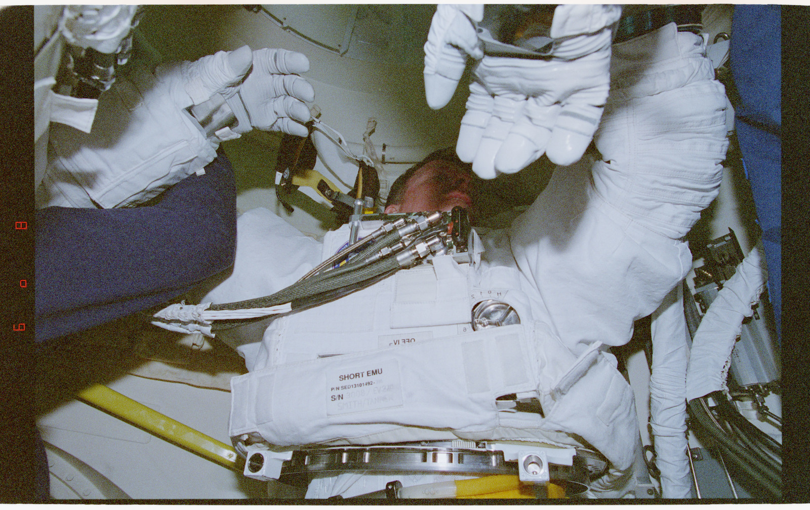 STS082-356-035 - STS-082 - Suiting up activities in the external airlock