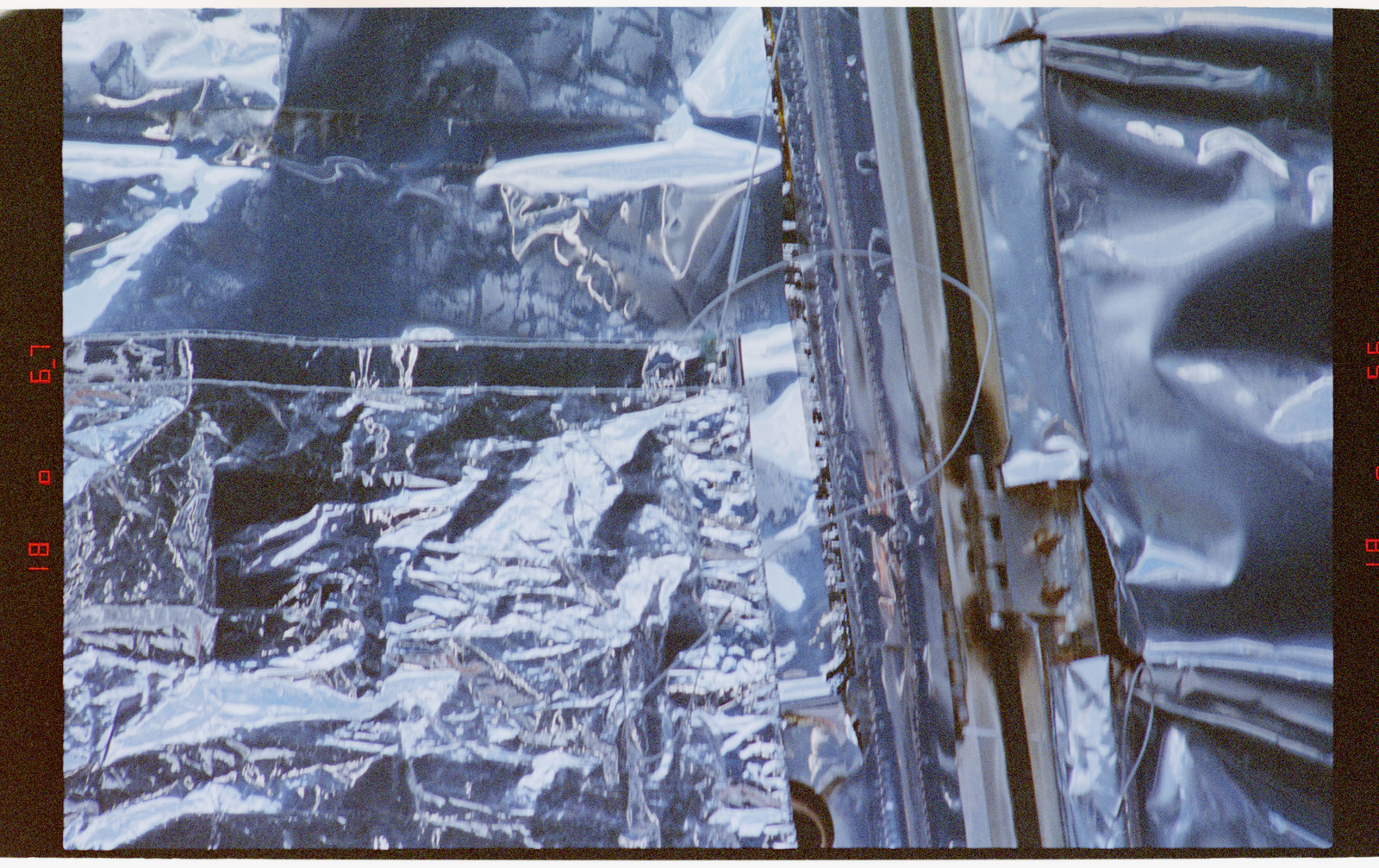 STS082-357-017 - STS-082 - HST, closeup details of Multilayer Insulation (MLI) patches installed