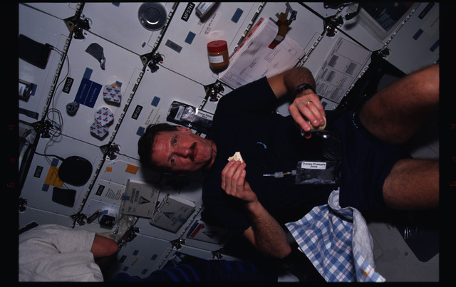 STS082-381-019 - STS-082 - Crewmember activities in the shuttle middeck on day off