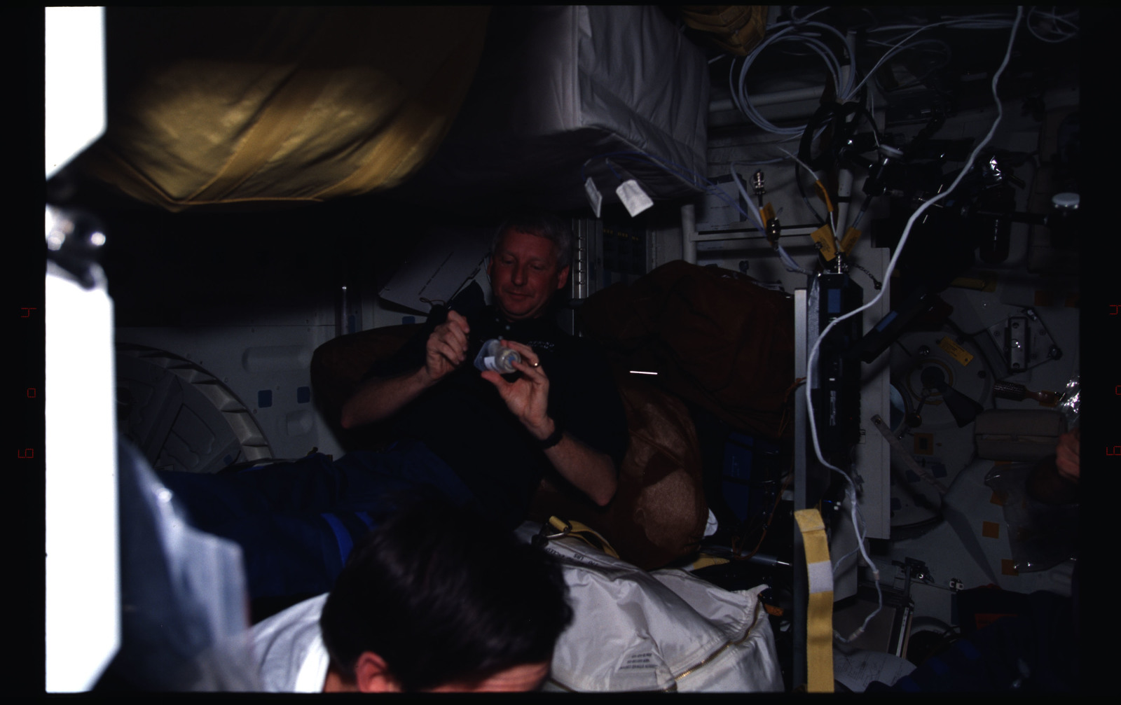 STS082-381-021 - STS-082 - Crewmember activities in the shuttle middeck on day off